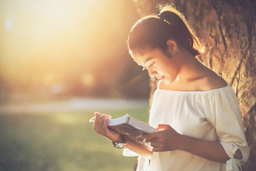 Lady Reading A Book For Fast Learning