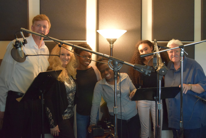 Here is the whole crew at Tom Smth Recording Studios. Greg, Stephanie, Eliana,Genesis,Wisdom, and Tom.