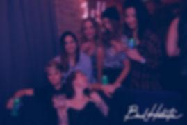 LGBTQ women hanging out and having fun at a bad habits social party