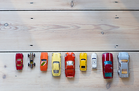 Toys, cars on starting line