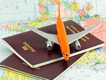 Toy airplane on passport on world map