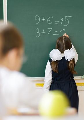 girl writting on a black board