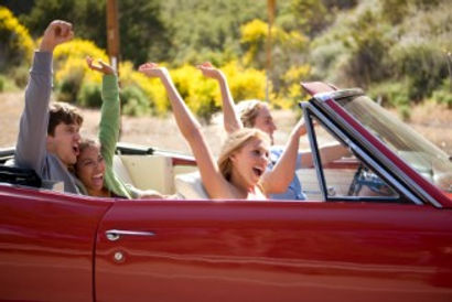 Four Young People in convertible car