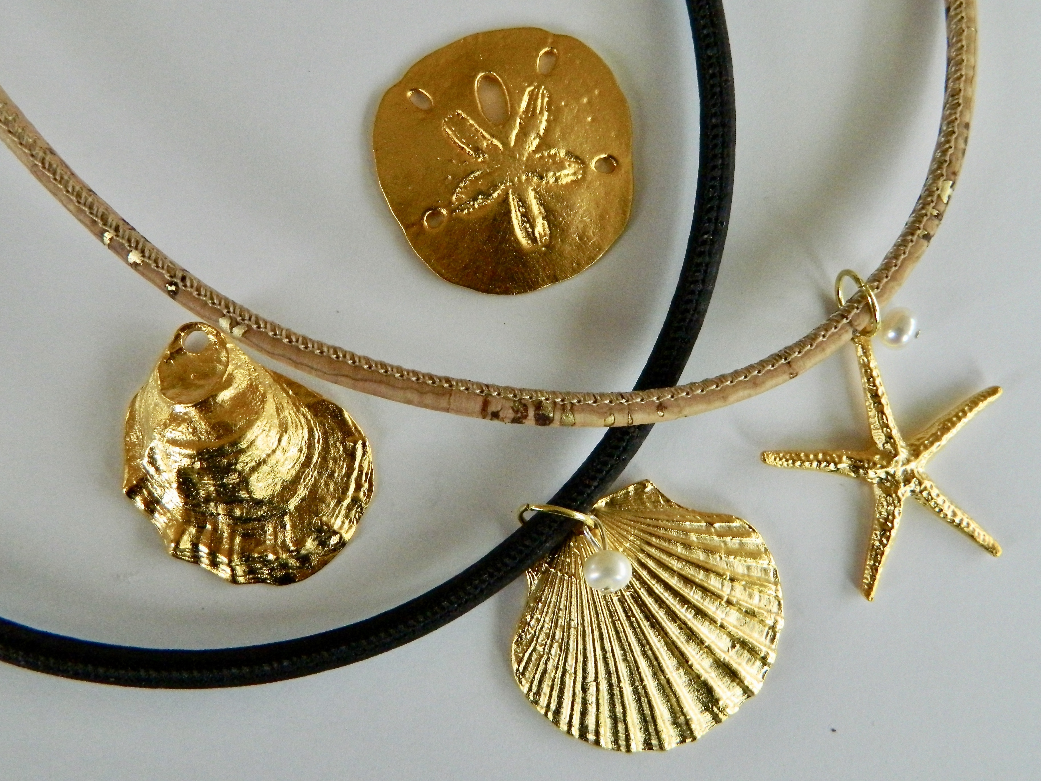 Gold Plate Pendant Necklaces on Cork
