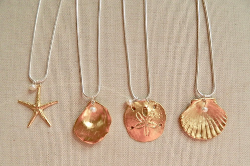 GOLD PLATE NAUTICAL PENDANTS ON SILVERPLATE