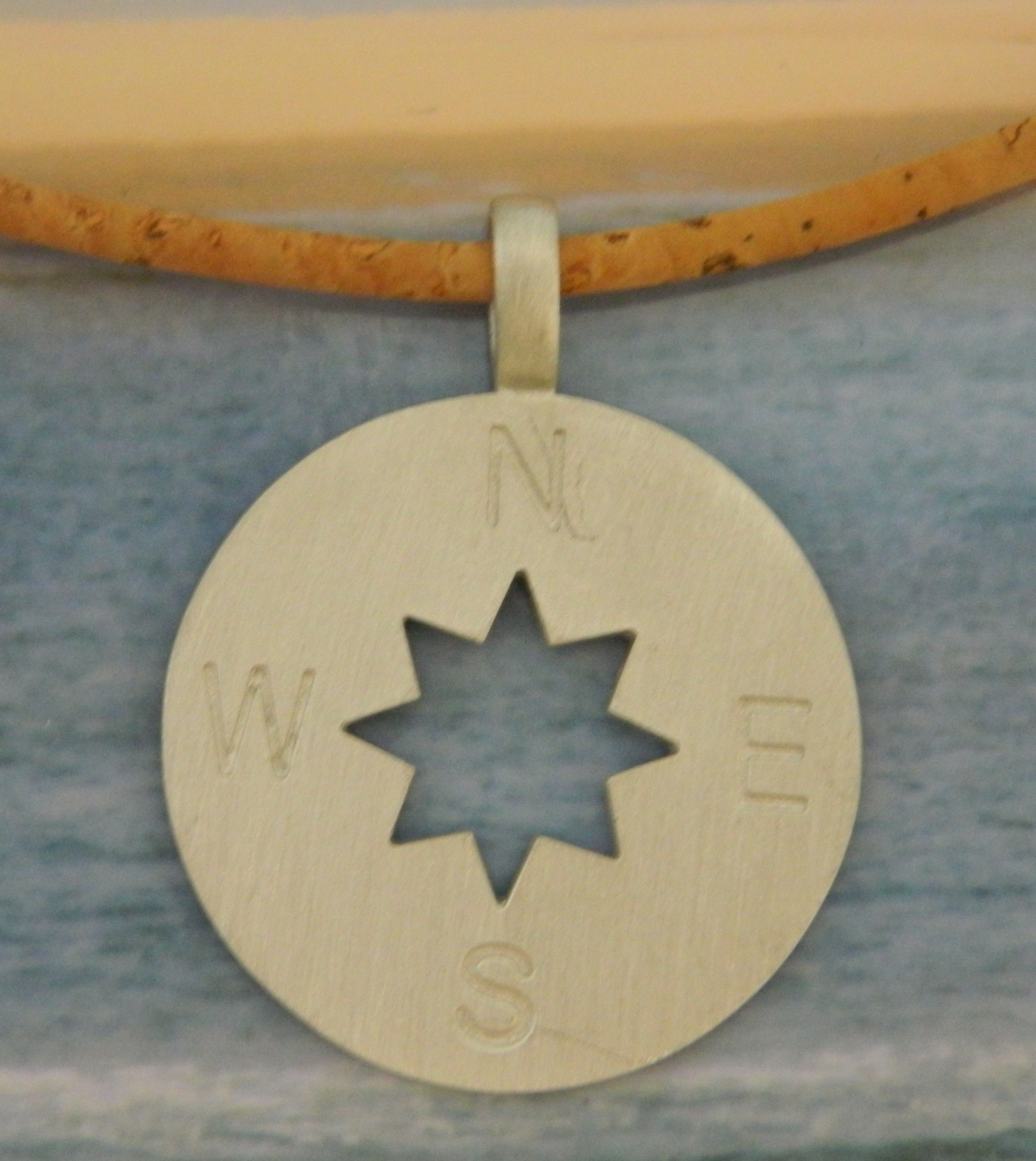 Pewter Compass Rose Necklace on Cork