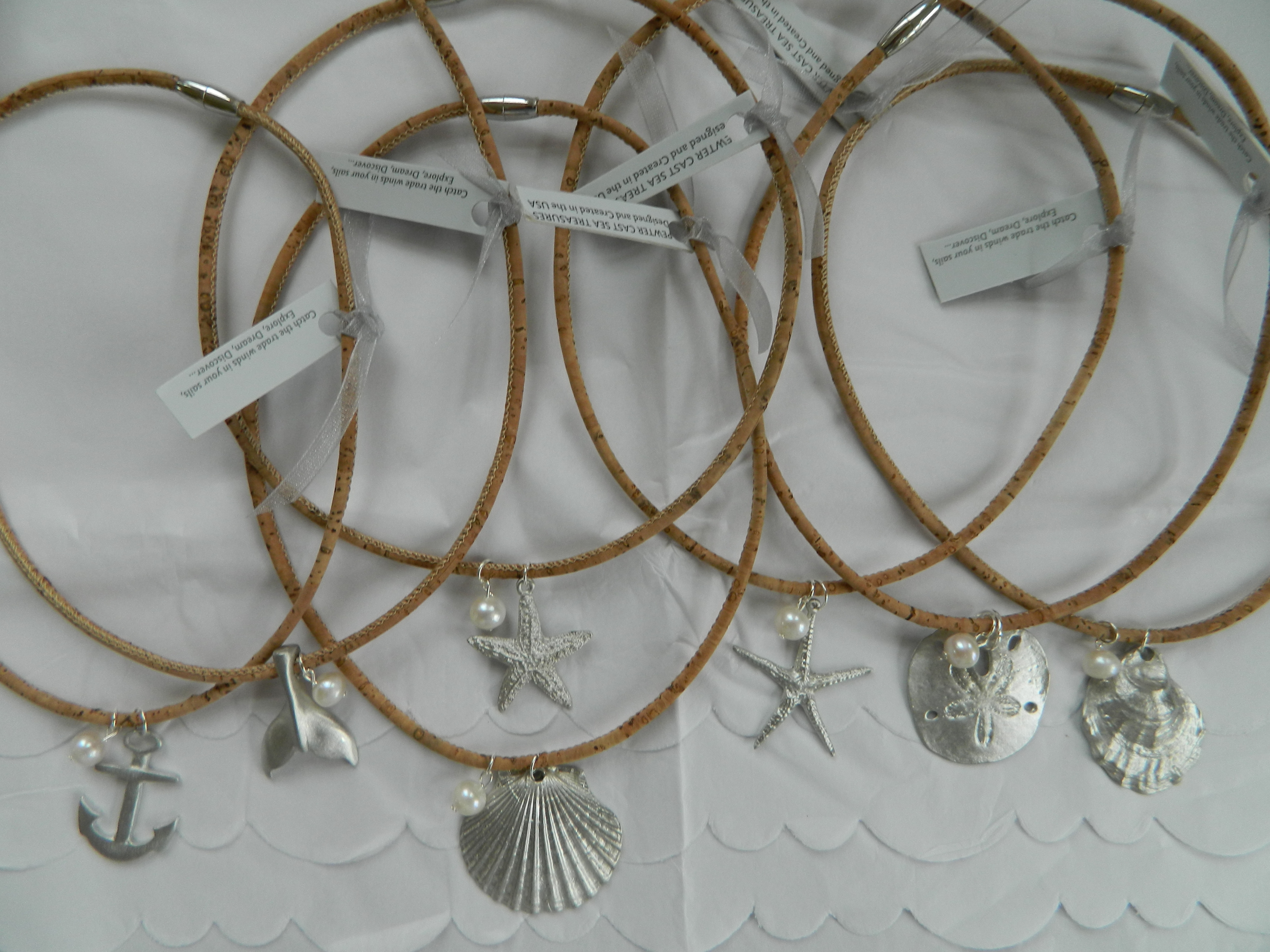 Pewter pendants with pearl on cork