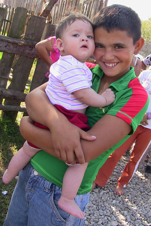 Roma teenage boy with baby.JPG