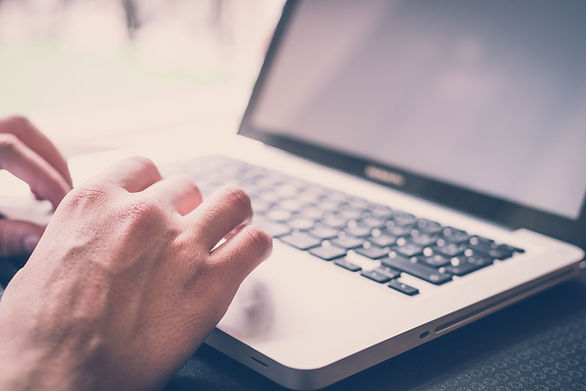 laptop with hands typing