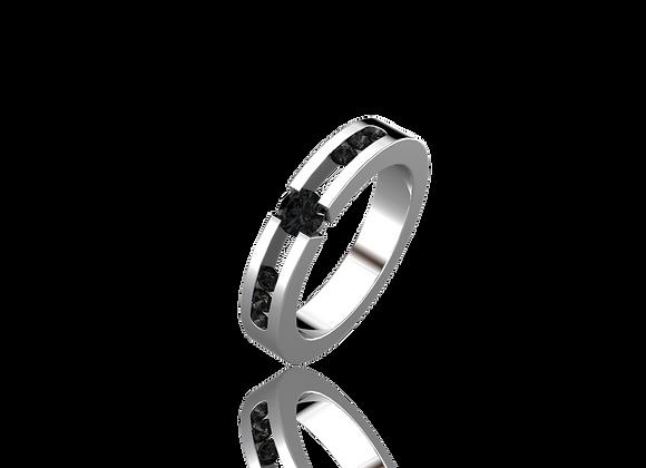 Bague sertie tension or et diamants noirs
