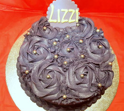 Divine Chocolate Cake Topped with a purple vanilla buttercream