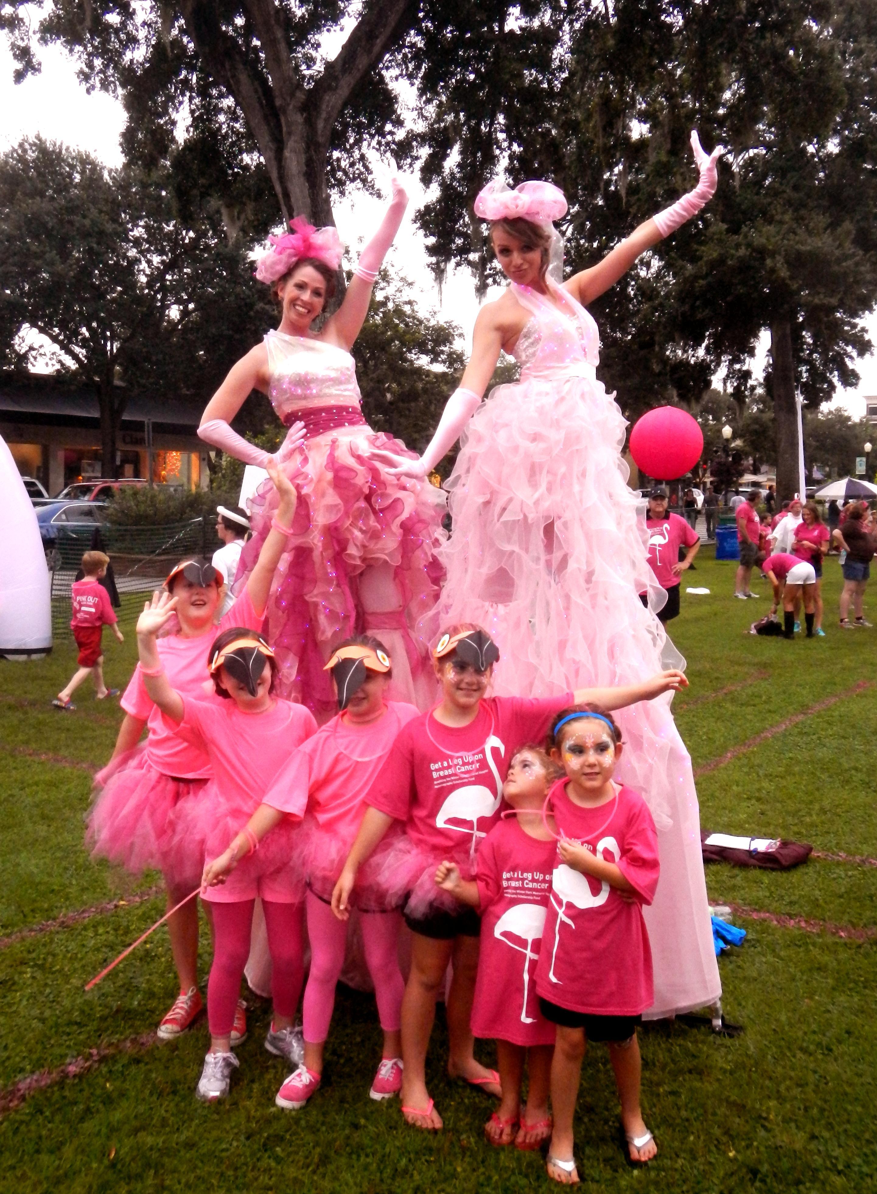 Pink stilt walkers