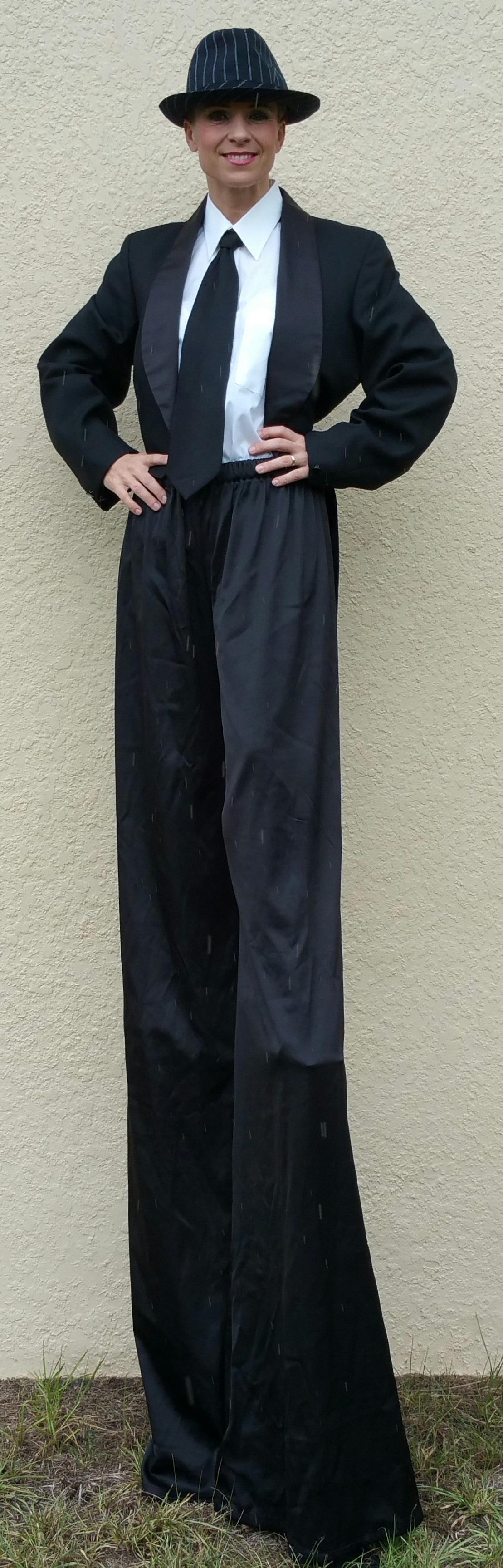 Tuxedo girl stilt walker