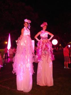 Light up pink stilt walkers