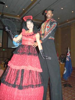 Spanish couple stilt walkers