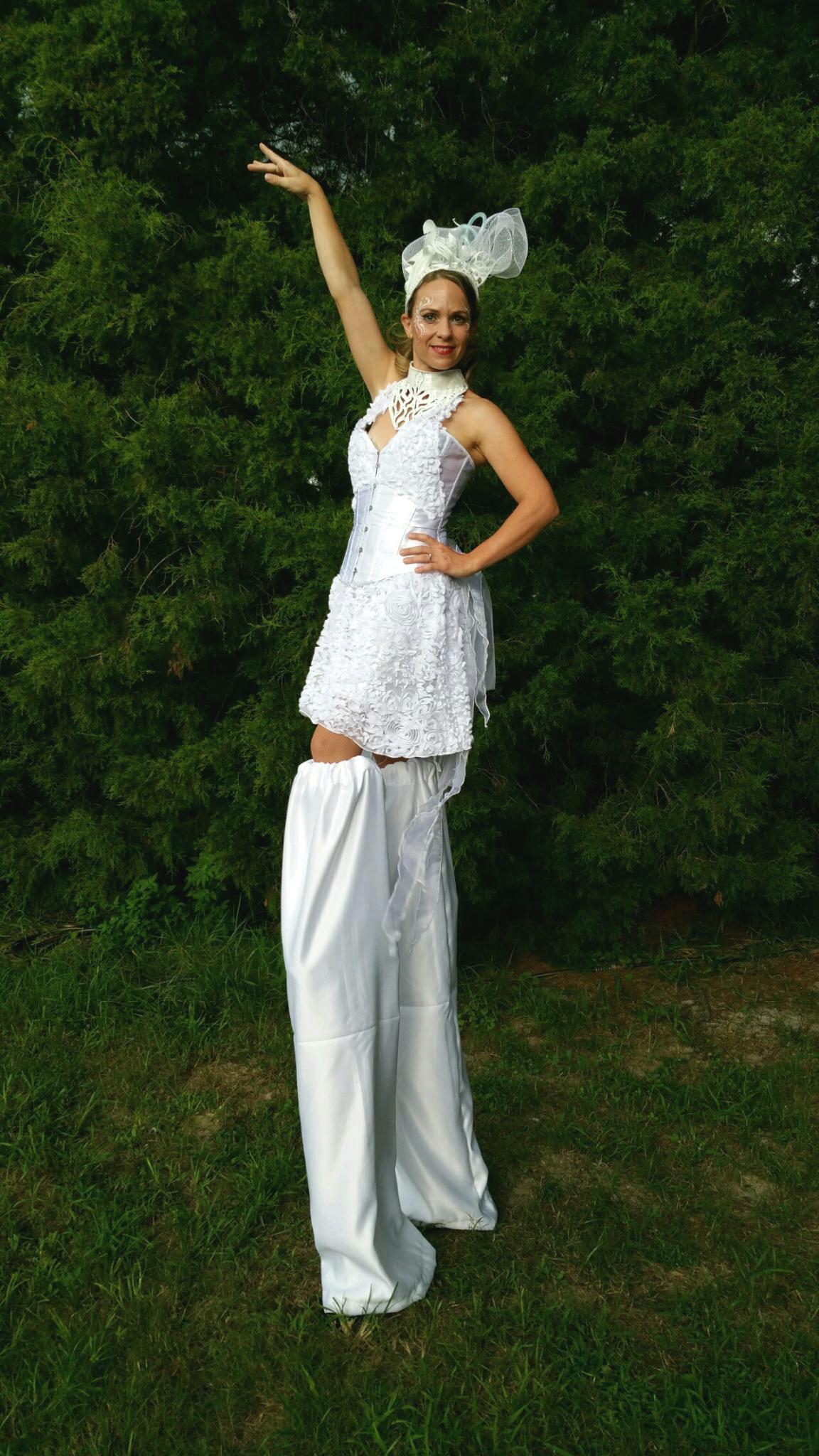Elegant all white stilt walker