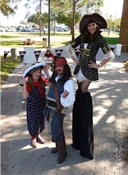 Female pirate stilt walker