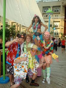 Tacky tourists and stilt walker