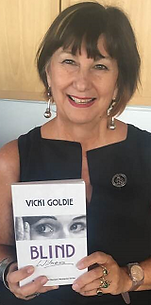 Vicki Goldie photo with book.png