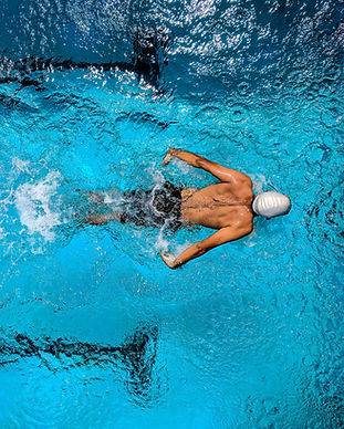 person-swimming-on-body-of-water-863988.