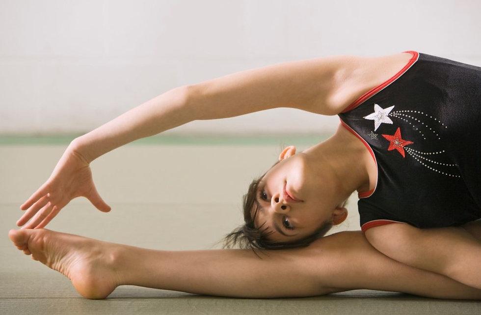 Canva-Flexible-gymnast-stretching-2-1024