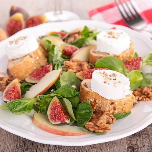 Salade de chèvre chaud au miel, pomme, figues et noix