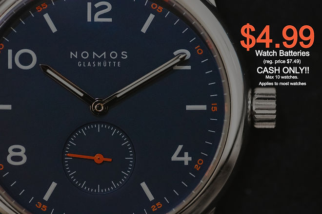 round%20silver-colored%20Nomos%20watch%20at%2010_10_edited.jpg