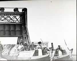 the crew are posing for the photograph, probably in 1900