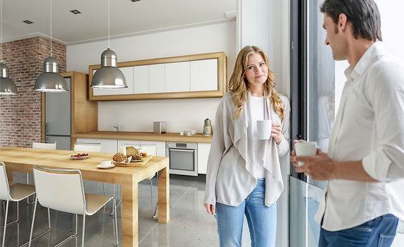 Couple in new kitchen