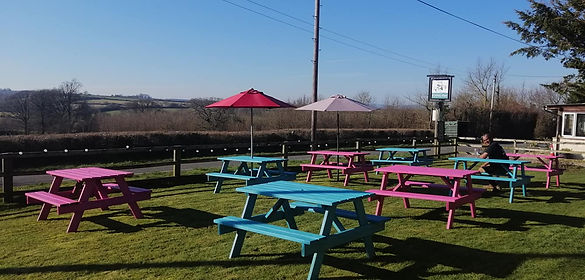 pub garden with painted benches and Budd