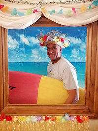 buddy with surfboard caribbean party.jpg