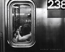 urban-romance-kissing-in-subway-window_u-L-F57P7U0.jpg