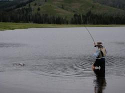 Landing a grayling on Cascade Lake