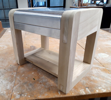 Bedside table with a hidden compartment