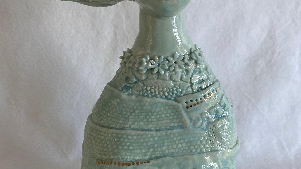Windswept porcelain bust.