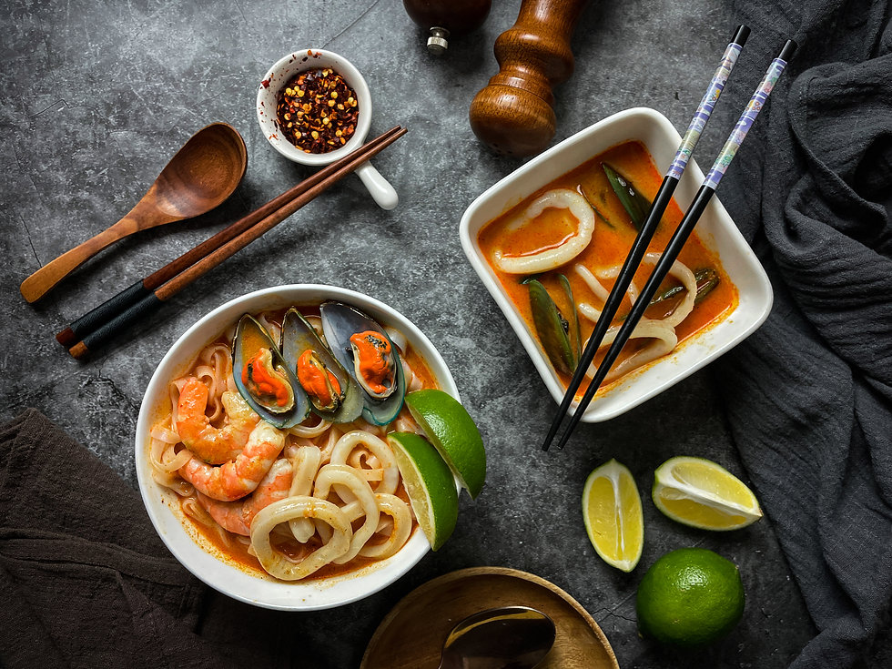 Seafood laksa noodle soup. Filled with squid, mussels, shrimp on top of your noodles.
