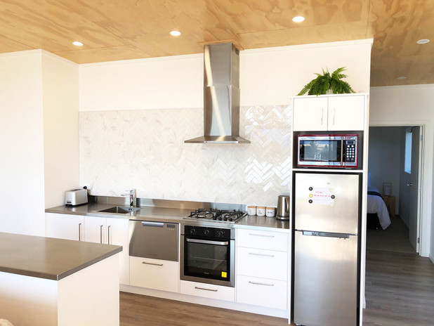 Full kitchen with gas stove top