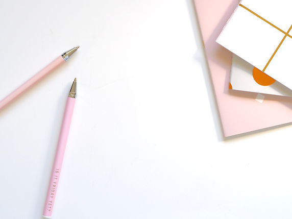 Canva - Two Pink Ballpoint Pens on Table