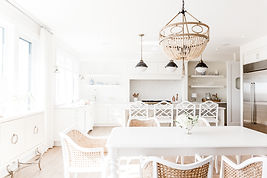 Photo of a coastal dining room and kitchen space