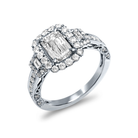 EMERALD CUT DIAMOND RING WITH HALO AND TAPERED BAUGETTES