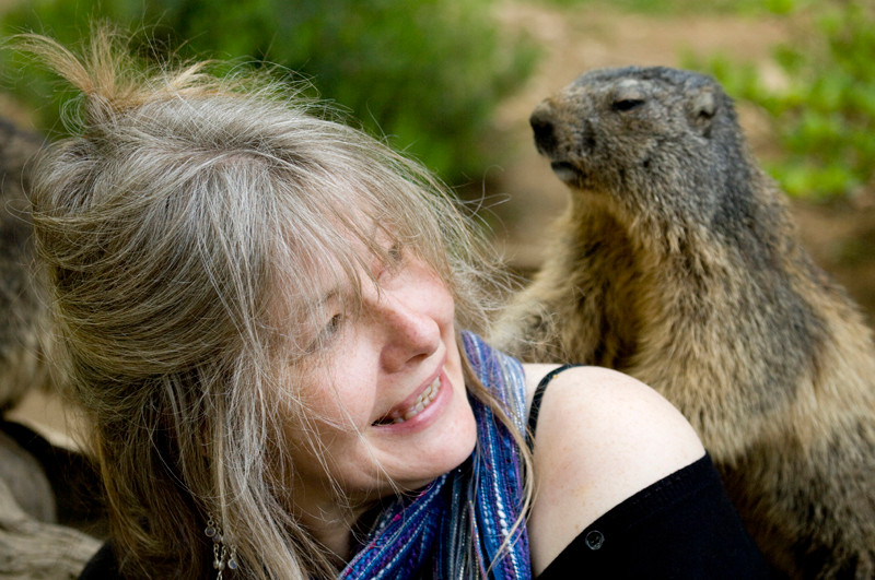Dr Meriel Lland, author, with marmot on her back