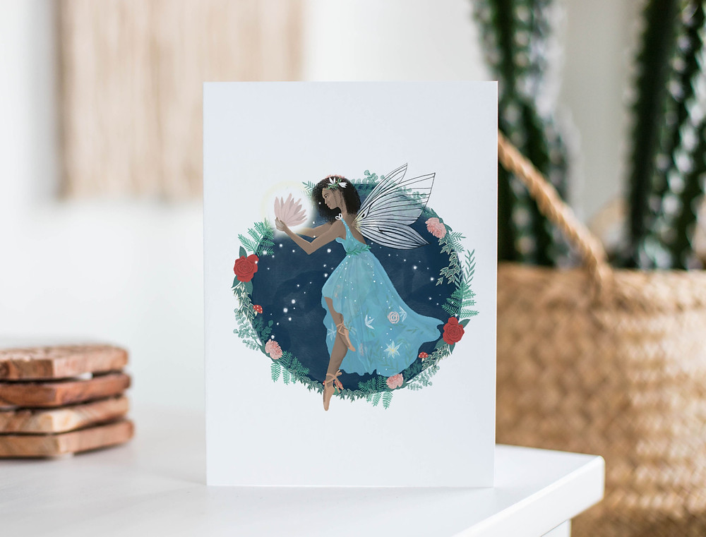 A recycled paper eco friendly card with a Black fairytale character on it, a fairy