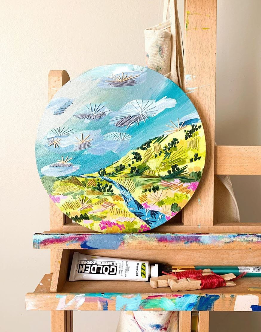 A beautiful landscape of paint and embroidery