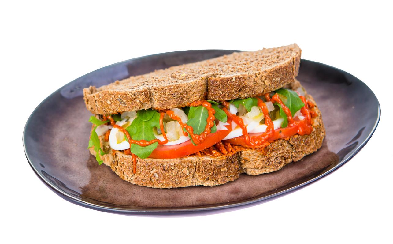 Filet american sandwich on plate
