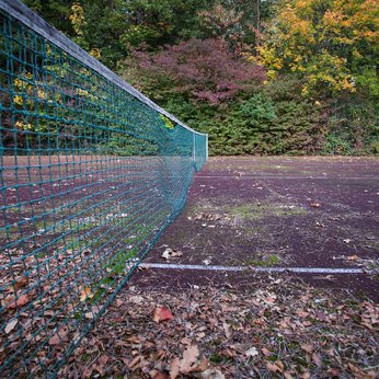Is your tennis court suffering from moss, is it starting to lose it grip or perhaps surface stones are beginning to spread across the surface. Do you have weeds or tree roots intruding through the tennis court surface? If so it sounds like it's time for some tennis court maintenance from Absolute Tennis Courts Ltd.  We posses over 25yrs experience in the tennis court industry, specialising in tennis court refurbishments and maintenance programmes. Call today and arrange a free, no obligations site visit.