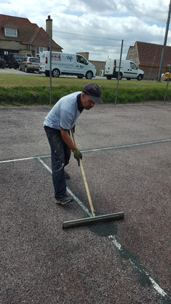 Tennis court lines being repaired