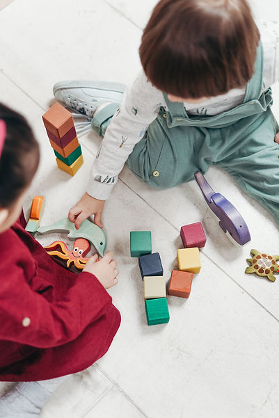 two-children-playing-with-lego-blocks-an