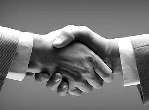 handshake_-_hand_holding_on_black_backgr