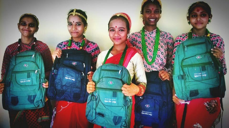 Distributing backpacks to local school
