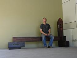 Public art bench in jarrah
